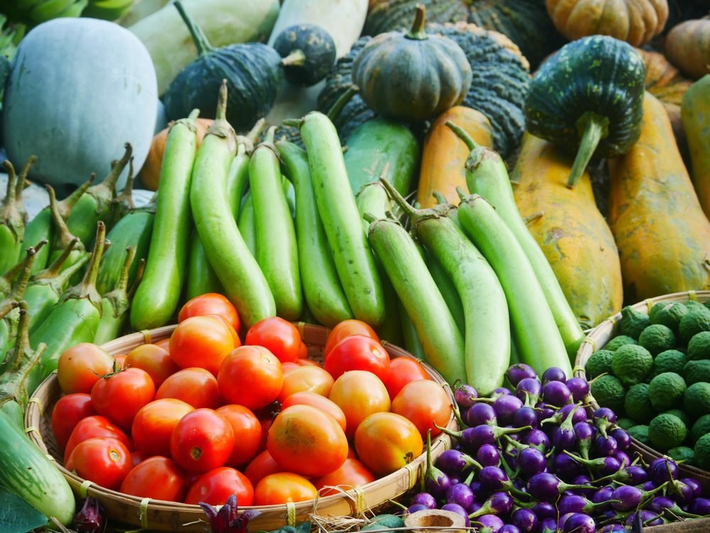 Fresh and colorful tropical vegetables and fruits from organic garden.