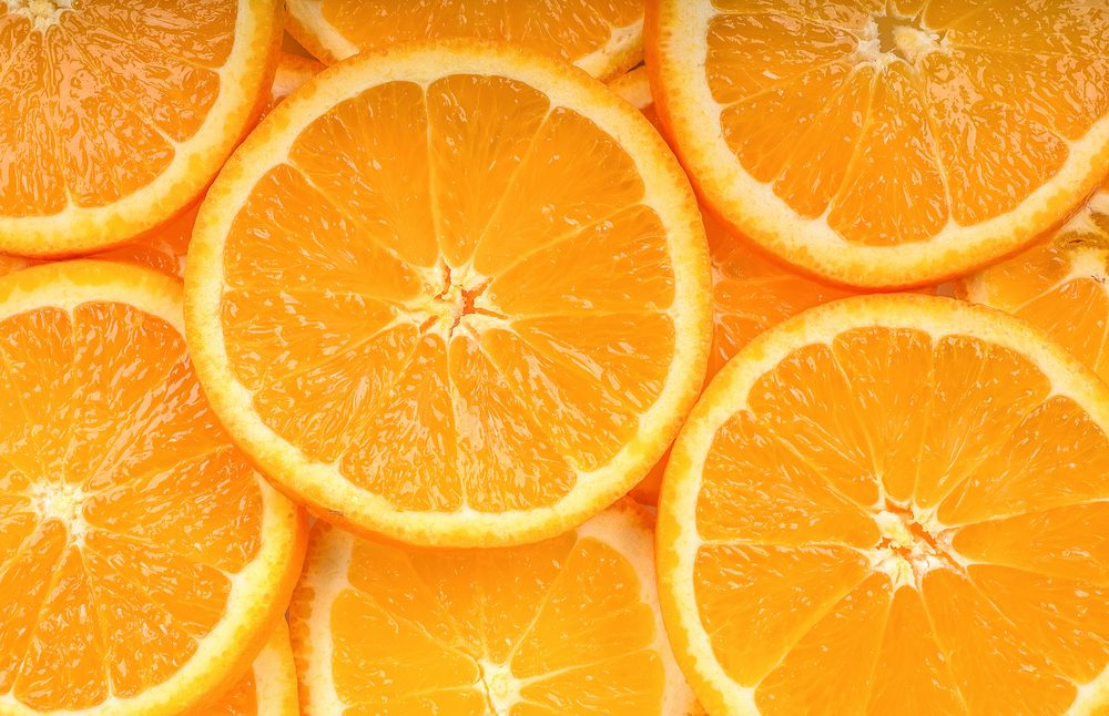 Close up slice orange fruit background texture.