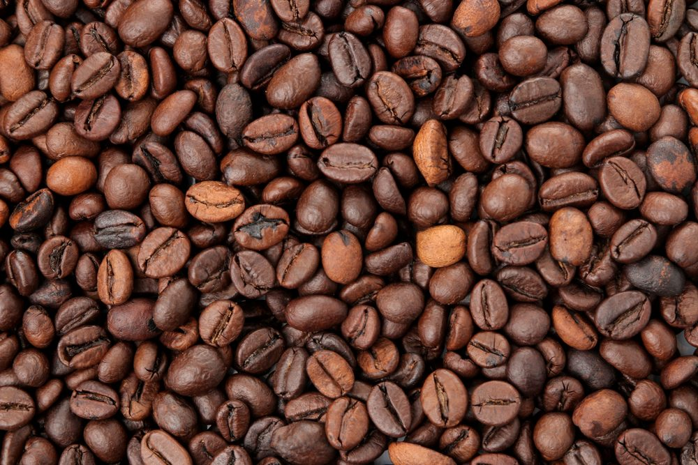 many different types of coffee beans. Background of coffee. fried coffee beans. coffee beans
