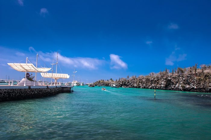 Pier for the ships on the Galapagos Islands. Ecuador. Pier of the Galapagos Islands. The Pacific Ocean is the island of Santa Cruz..