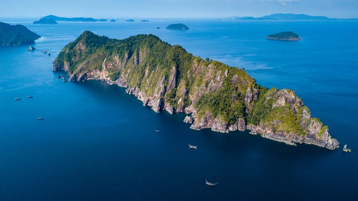 Large numbers of fishing boats off a remote tropical island in the Mergui Archipelago, Myanmar