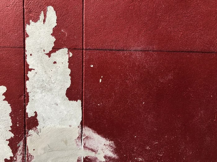 Old terracotta painted stucco clay wall paint. Abstract red paint wall texture background.