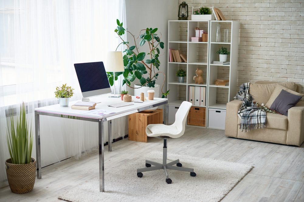 Background image of empty office space in cozy apartment with modern Scandinavian design