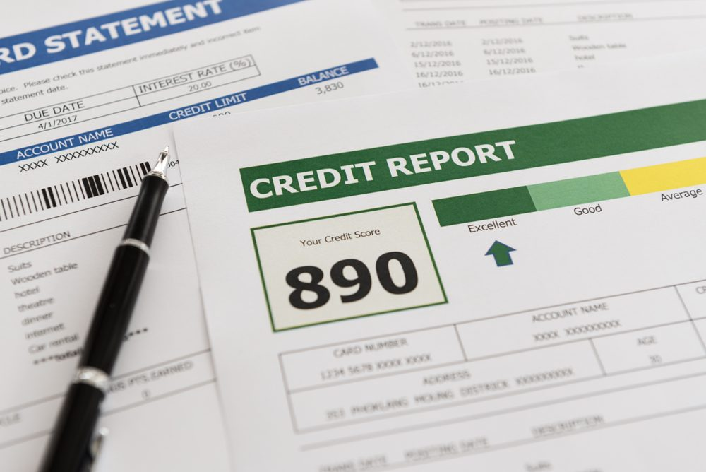 credit report and debt payment history document on desk.