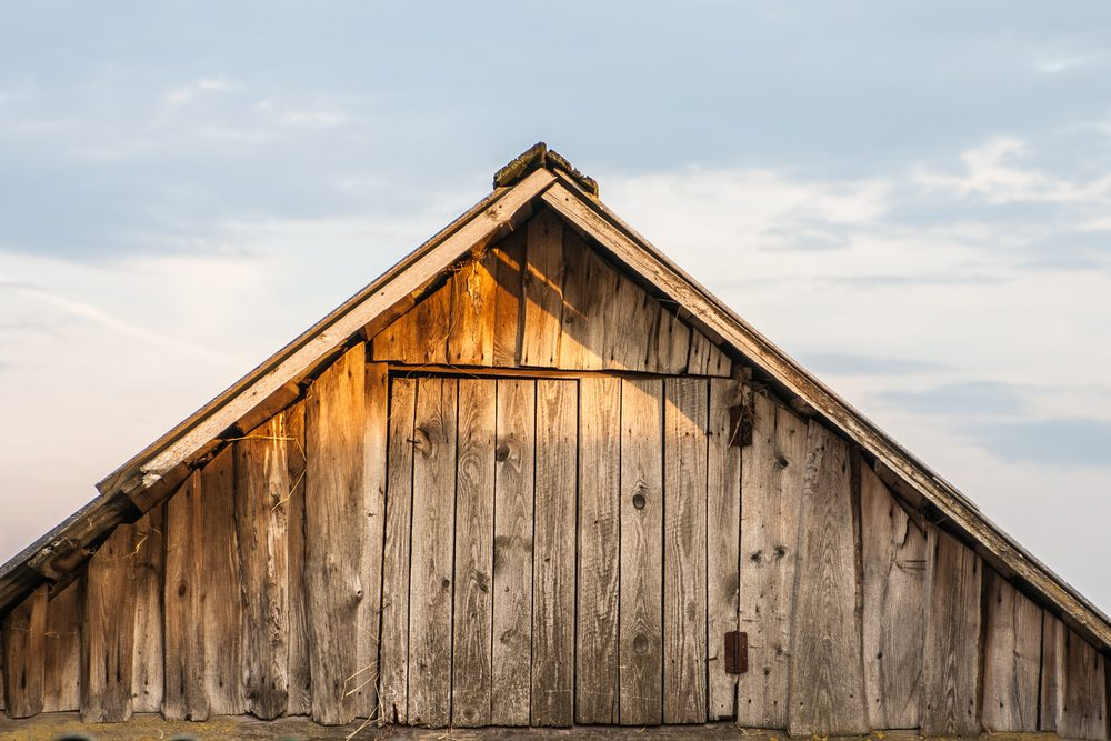 The old barn roof against the sky