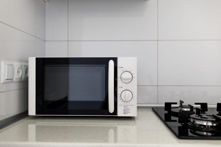 Modern kitchen interior with electric and microwave oven