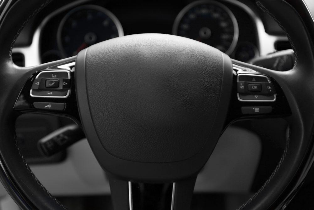 Modern car illuminated dashboard and steering wheel