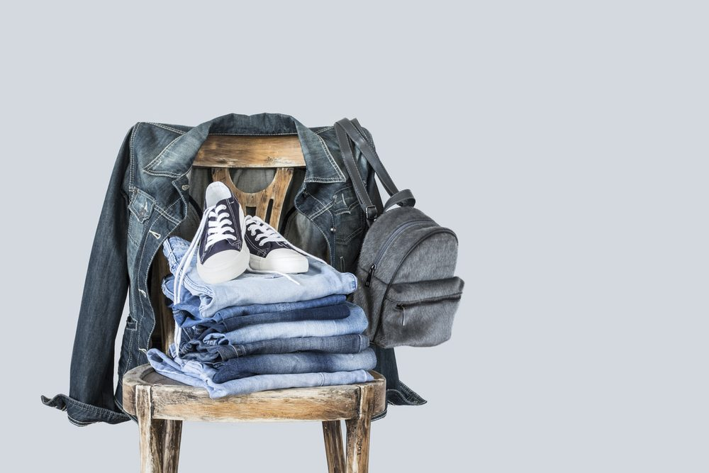 Stack of clothes on wooden chair