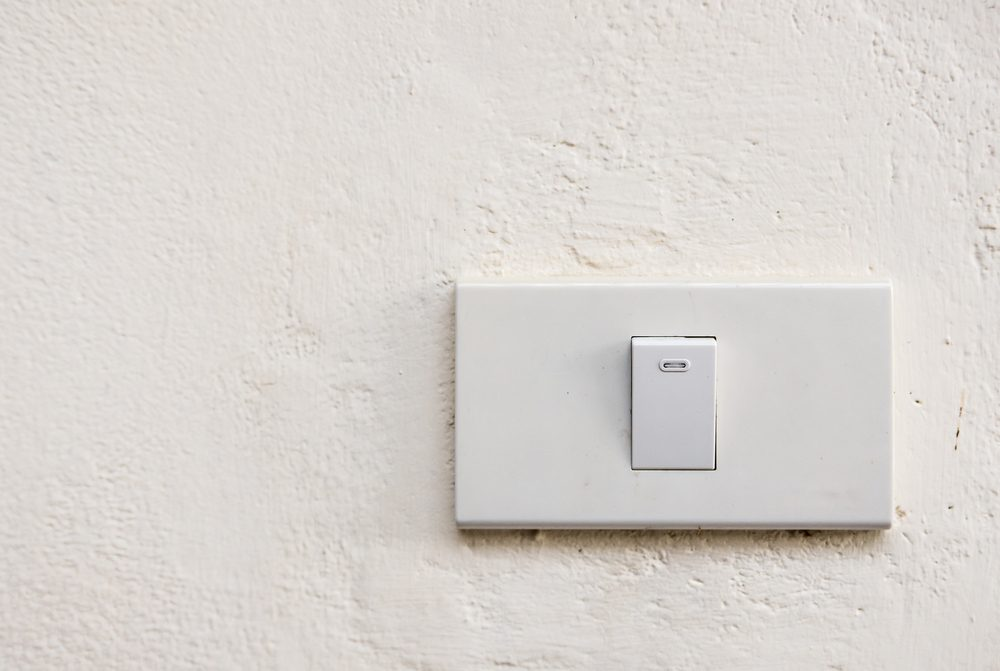 Lightswitch on concrete wall