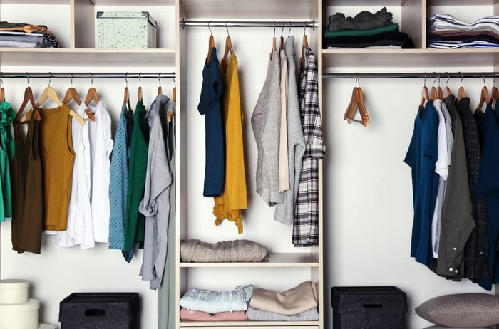 Large wardrobe closet with different clothes