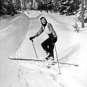 Mandatory Credit: Photo by Underwood Archives/UIG/Shutterstock (3837599a) Lake Of Bays, Ontario, Canada: c. 1956 A young woman turns in the cross country trail and smiles for the camera. VARIOUS