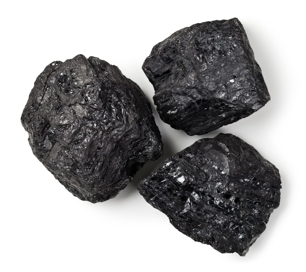Coal lumps on white background. Top view