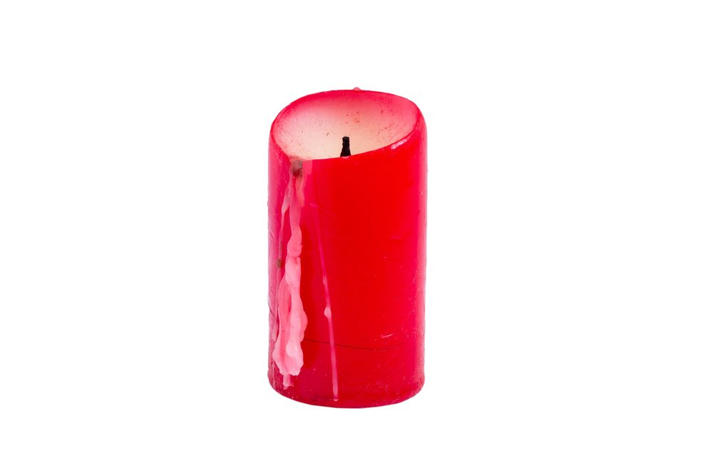 Red candle used with candle drippings