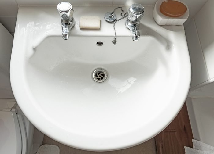 Sink, taps and soap bar from above