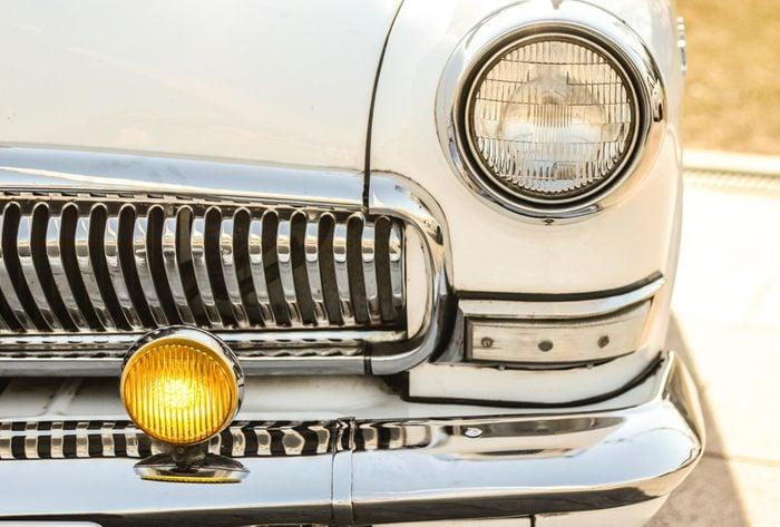 white retro car, with chrome bumper