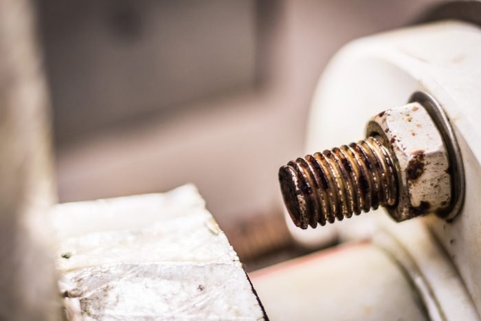 Rusty bolt and nut of water heater pipe, Texture of rust with blur background.