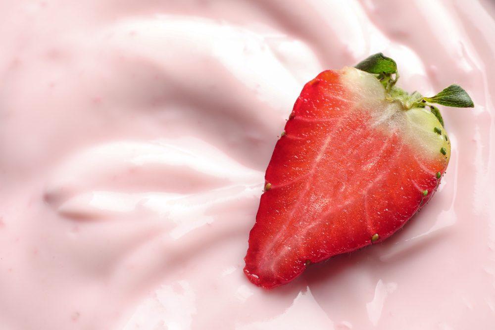 Tasty fresh yogurt with strawberry, closeup