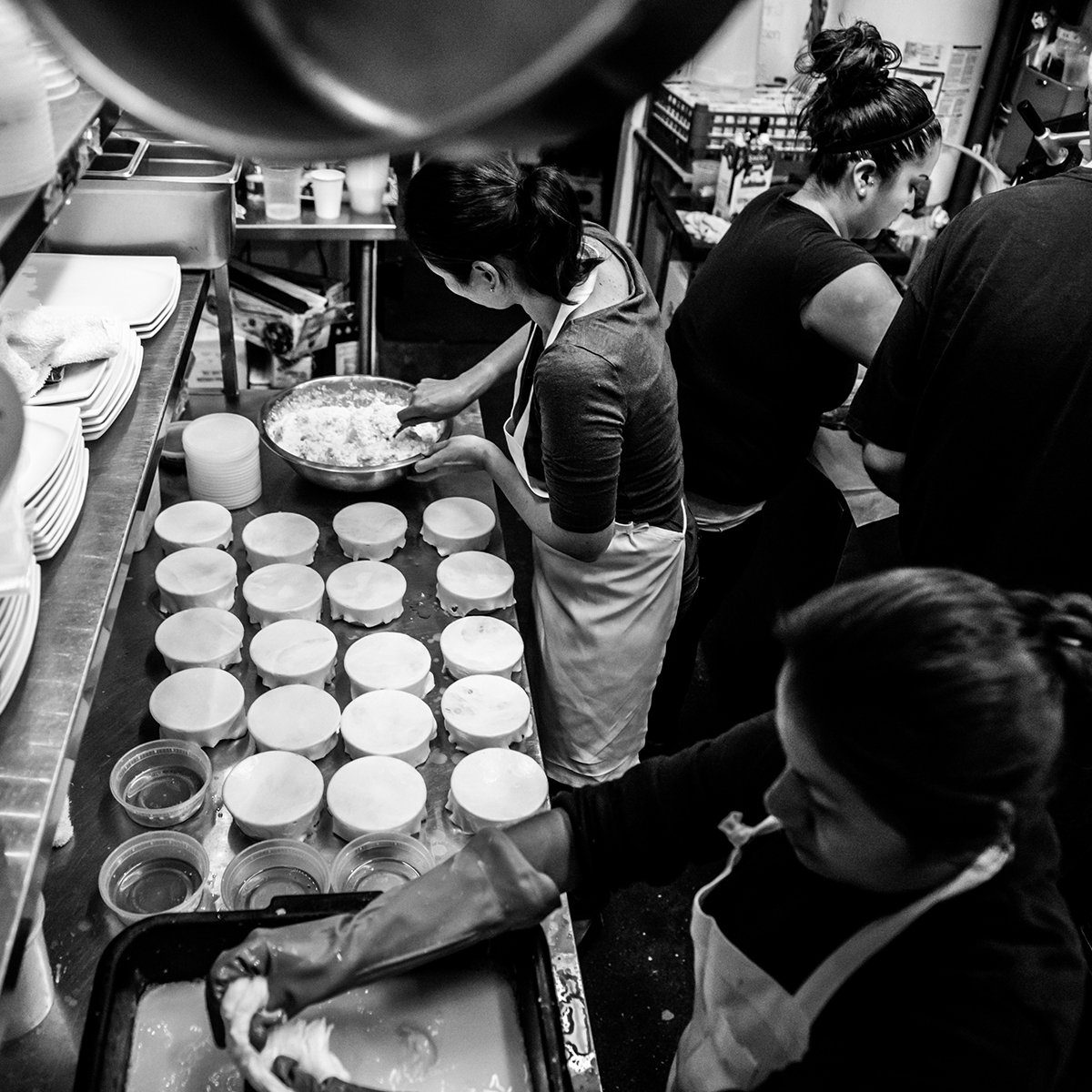 Black and white photograph of working in a restaurant kitchen