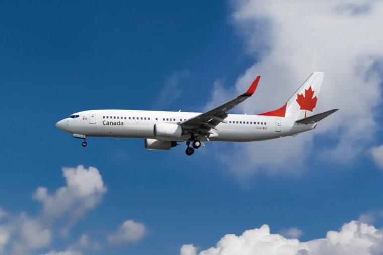 passenger aircraft airplane in the sky. canada maple leaf symbol on plane