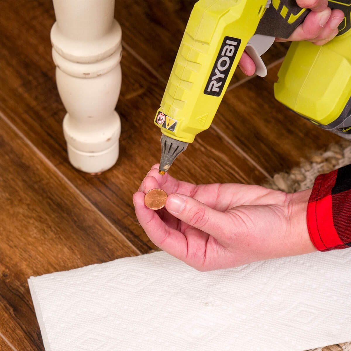 Hot Glue Gun Uses: Fix Wobbly Furniture with a Penny