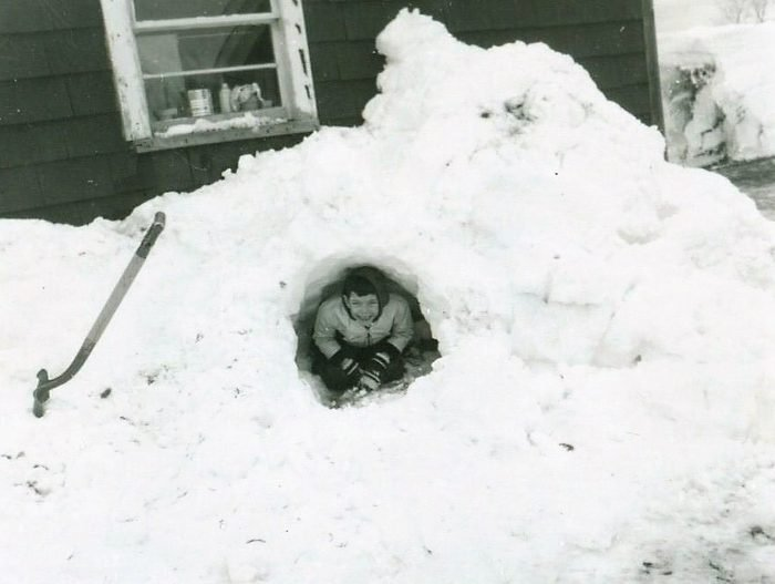 This picture brings back one of many wonderful memories of growing up in a US Air Force family. In 1963 our family was stationed for 3 years at Dow Air Force Base; Bangor; Maine. The picture is me and taken by my father who was a 20 year military veteran. It was probably my first time ever building a snow tunnel. You can see the excitement on my face that reflects how happy and proud I was. I can't help but smile; and get emotional when reflecting on this wonderful time of my life. ~ John Clagg; Jr.