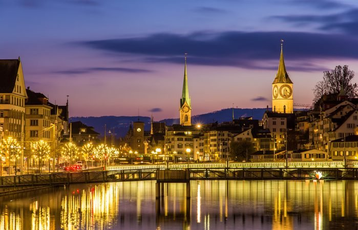 Zurich on banks of Limmat river on a winter evening