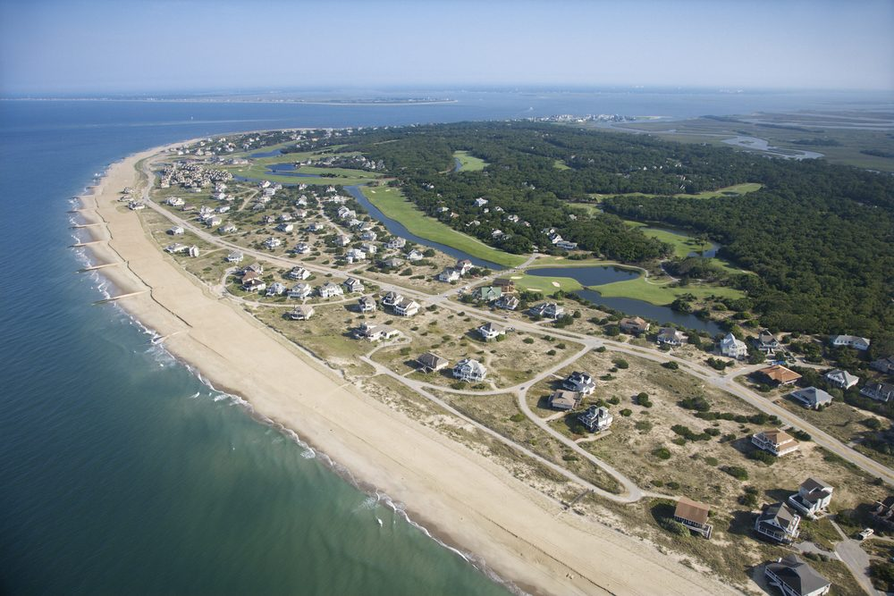 Aerial view of beach and residential neighborhood at Bald Head Island, North Carolina.