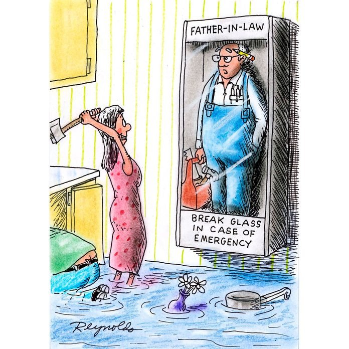 woman standing in a flooded bathroom about the break the glass of the Emergency Father-in-Law on the wall