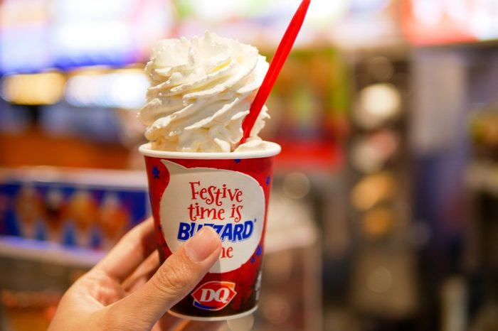 BANGKOK, THAILAND - DECEMBER 21, 2017: Dairy Queen at Siam Center branch in Bangkok, Thailand serve the blizzard ice cream caramel almond with whipped cream topping.