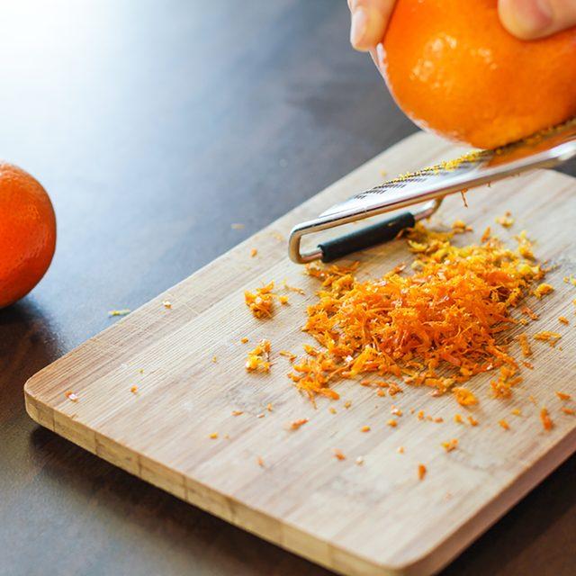 Mandarin zest on wooden board with couple of mandarins alongside; Shutterstock ID 554047369; Job (TFH, TOH, RD, BNB, CWM, CM): Taste of Home