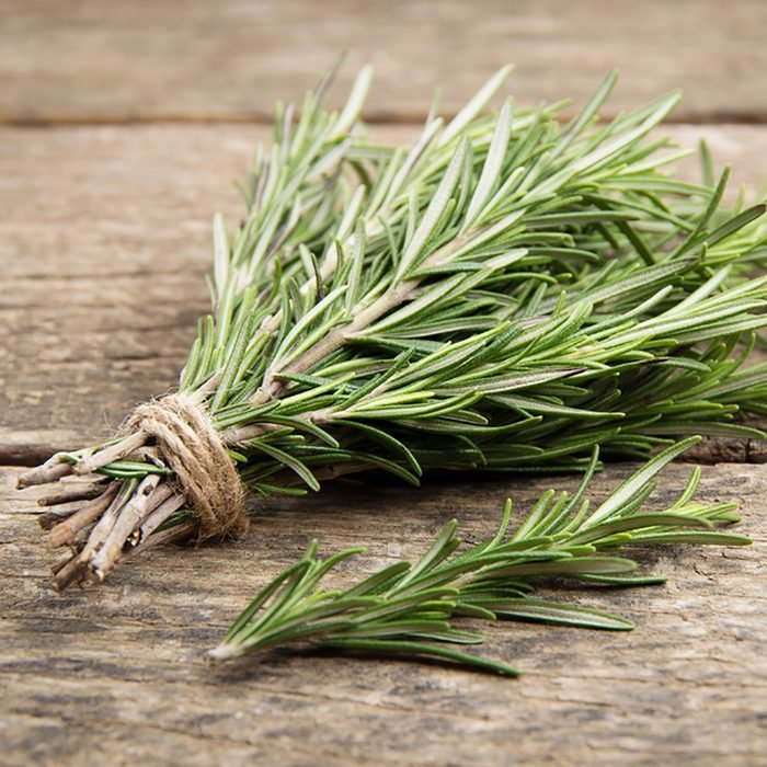 Rosemary bound on a wooden board; Shutterstock ID 567889069; Job (TFH, TOH, RD, BNB, CWM, CM): Taste of Home