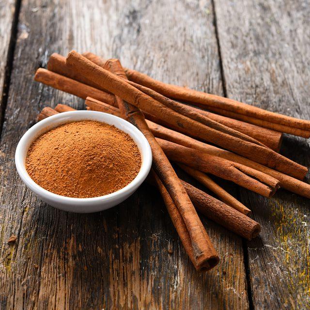 Cinnamon sticks and cinnamon powder on wood; Shutterstock ID 646377511