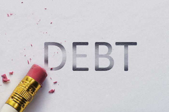 Pencil eraser with eraser. Erase DEBT text