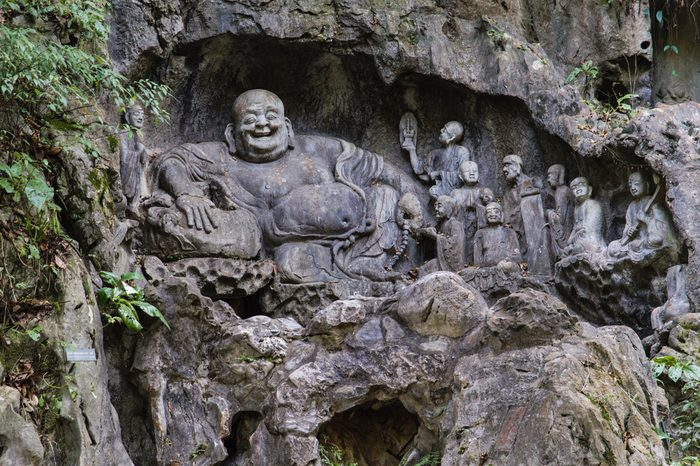 """Feilai Feng grottoes with fine buddhist stone carvings. It is called 'the Peak that Flew Hither"""" or """"Flying Peak"""" and is located in front of the Lingyin temple."""
