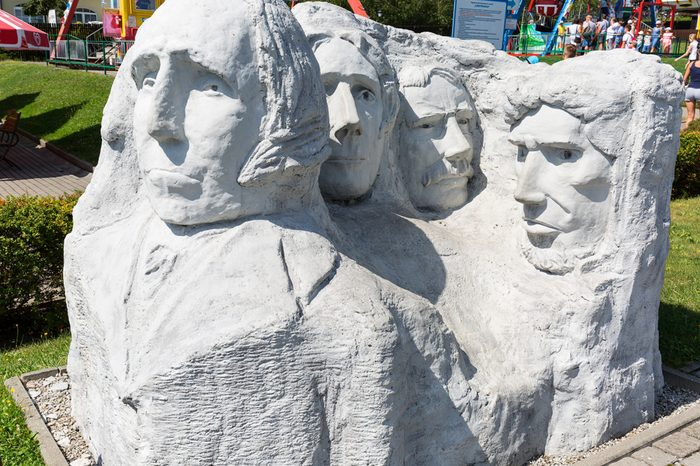 """INWALD, POLAND - AUGUST 12, 2018 : Miniature Park """"Dream world"""", small Mount Rushmore- sculptures of USA presidents (Dakota) in 1:25 scale"""