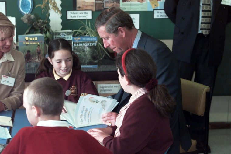 Prince Charles Reading His Book 'the Old Man Of Lochnagar' Which He Found On A School Desk At St Marks Primary School Brighton.pic Mike Forster