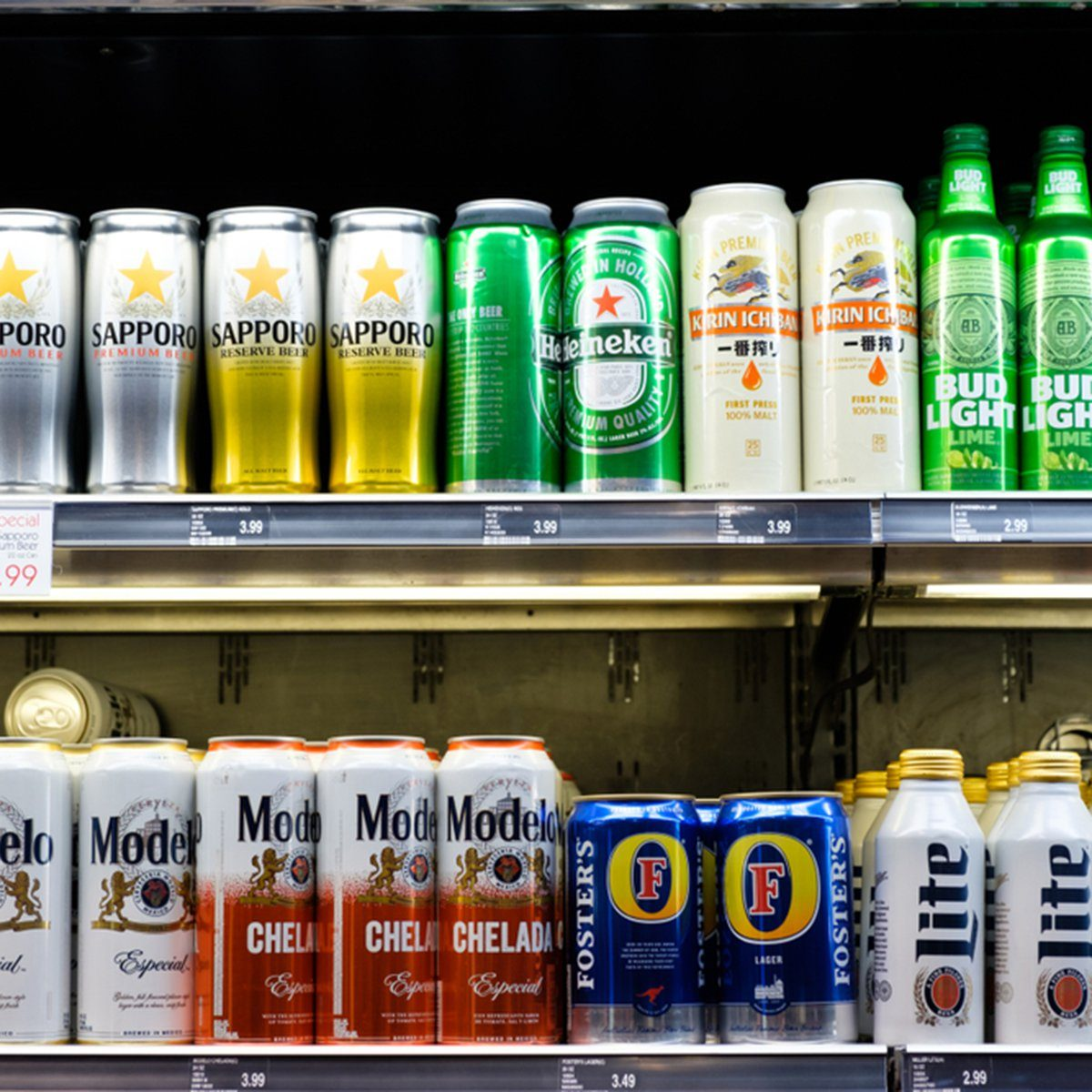 Wide selection of domestic and imported beer on shelf display in a convenient store
