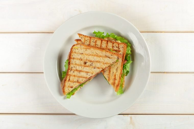 Club sandwich on wooden table