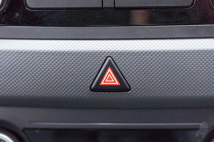 Emergency button on the car panel. Alarm button in the car