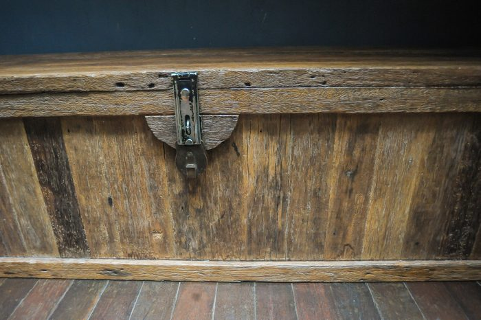 Old wooden chest with closed lit