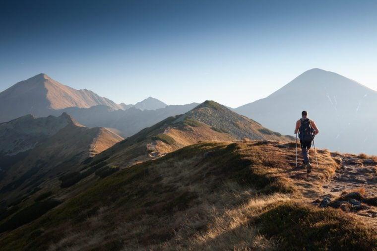 Backpacker at Ornak Peak in Tatra Mountains, Poland