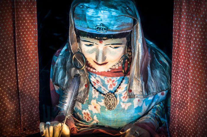 Retro fortune telling gypsy in an amusement arcade.