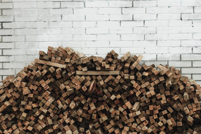 Preparation of firewood for the winter. firewood background, Stacks of firewood in the forest