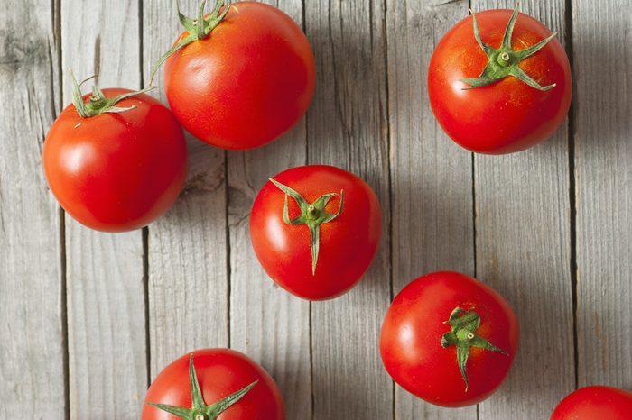 beautiful ripe tomatoes on wood surface