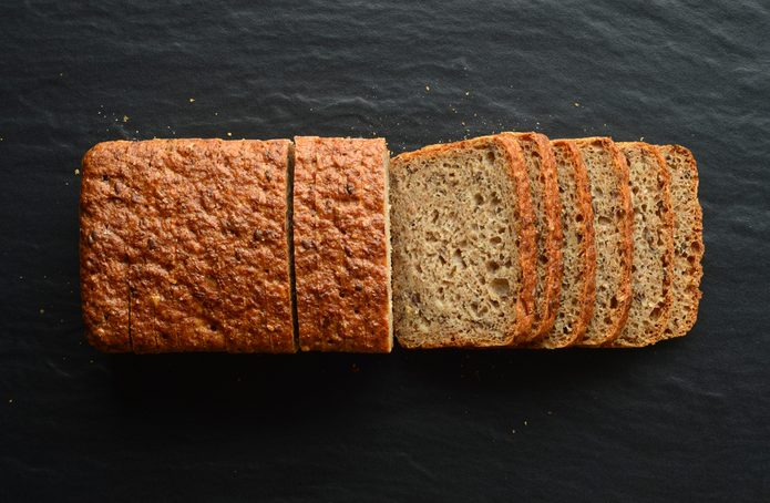 Whole wheat bread on a black stone plate