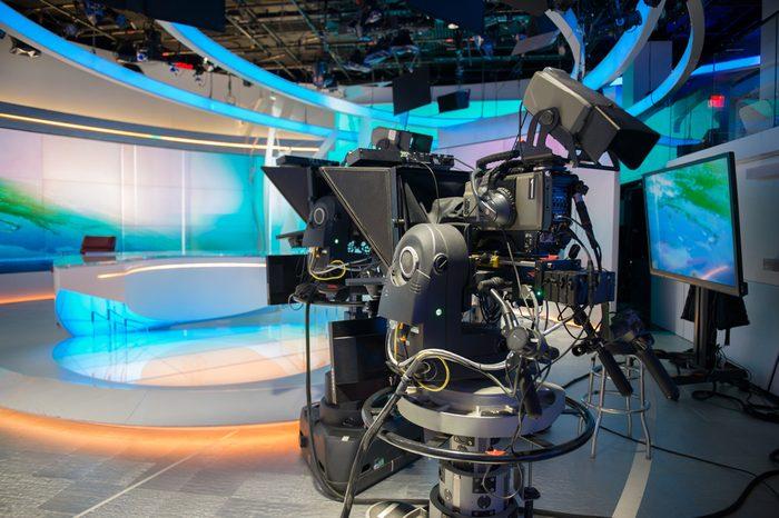 TV NEWS cast studio with camera and lights