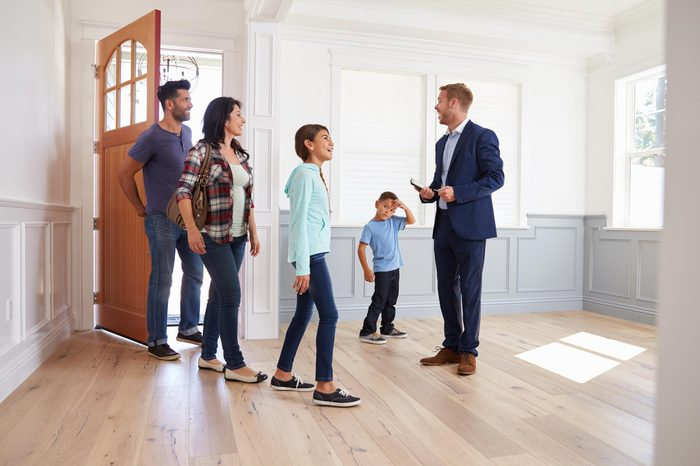 real estate agent show family house