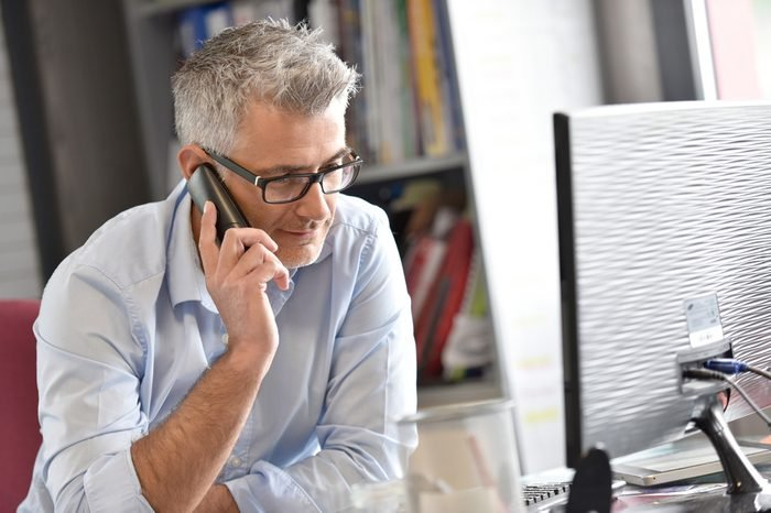 Businessman in office talking on phone