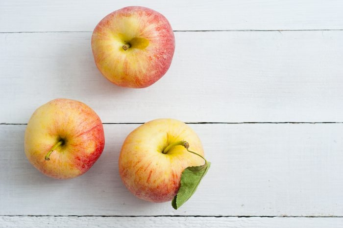 apples on white wood table background