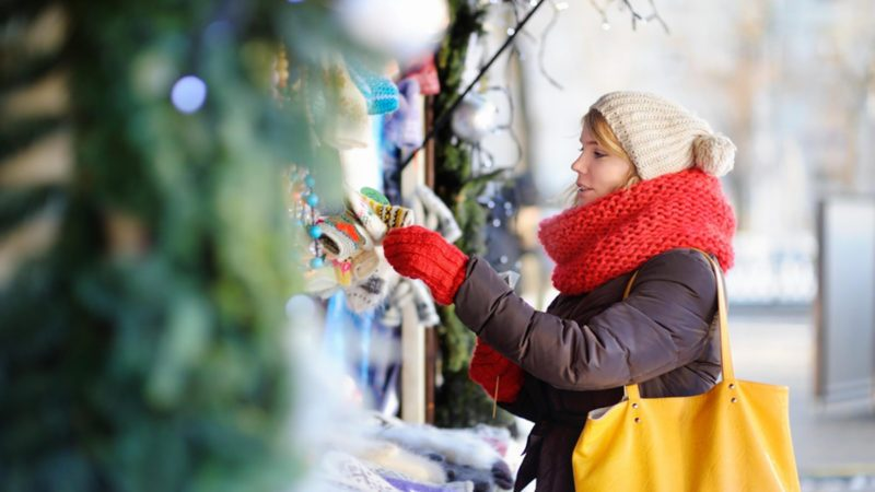 Outdoors portrait of young beautiful woman on a Christmas market; Shutterstock ID 522316591; Job (TFH, TOH, RD, BNB, CWM, CM): Taste of Home